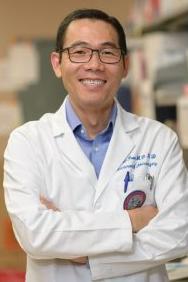 Dr. David Tran smiling in his lab