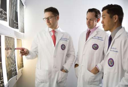 UF Health neurosurgeons Dr. William Fox, Dr. Adam Polifka and Dr. Daniel Hoh