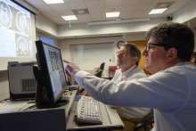 Dr. Bova and Dr. Friedman planning SRS