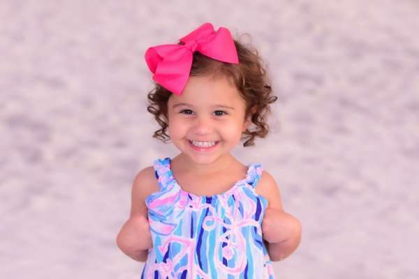 Sophia on beach, closeup